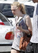 Dakota Fanning- Leavng  A gym July 29th 2010(LQ)